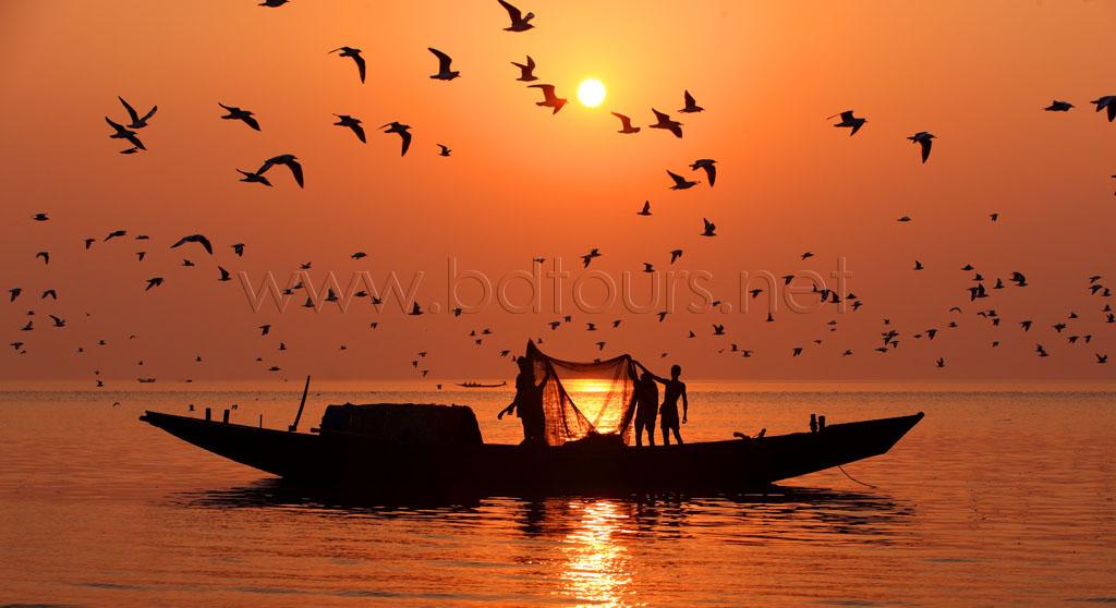 Fishing boats at Dublar Char, an island located at the southern border of the Sundarban, facing the Bay of Bengal. Khulna, Bangladesh December 2010.